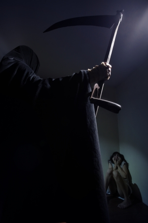 Grim reaper menace a young woman scared Stock Photo - 17054009