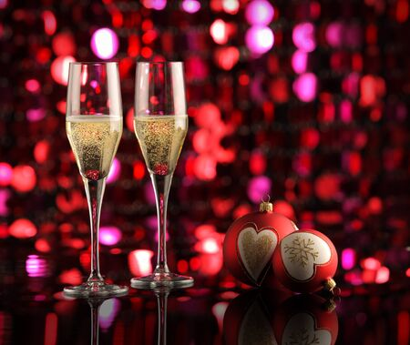 Glasses of champagne with Christmas decorations photo