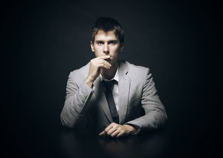 Portrait of a young businessman on black background Stock Photo - 17054053
