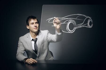 Car designer draws his dream car Stock Photo - 17053997