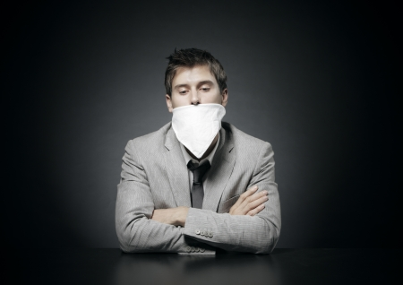 gagged: Young  businessman with censorship gag on his month  Stock Photo