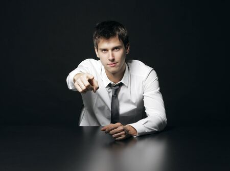 Portrait of a young businessman pointing at you Stock Photo - 17053985