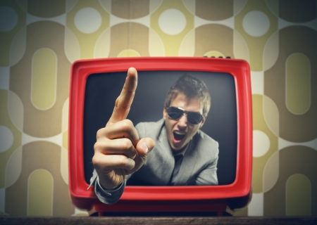 Anchorman pointing his finger and screaming in vintage tv photo