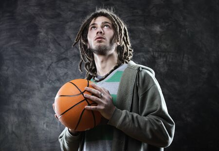 Basketball player taking the shot with a basketball photo