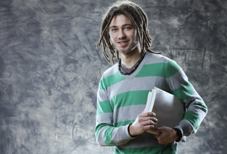 dreadlock: Portrait of smiling young student with books Stock Photo