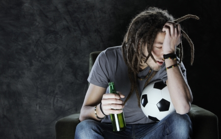 Soccer Failure.Young adult man watching football on television, we have lost the game  photo