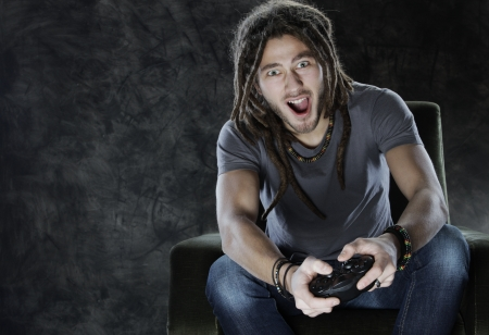 playstation: Young man enjoys playing games Stock Photo