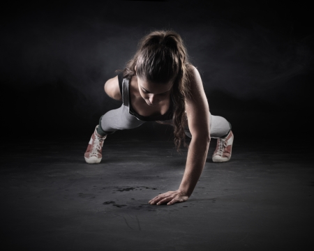sports clothing: Young Woman Doing Push-Ups