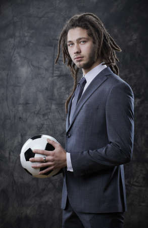 Portrait of a businessman with a soccer ball photo