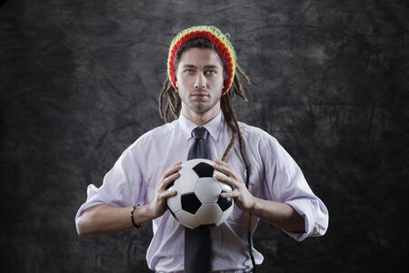 Portrait of a bizarre businessman with a soccer ball photo
