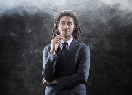 Rastafarian businessman smoking marijuana Stock Photo - 17408713