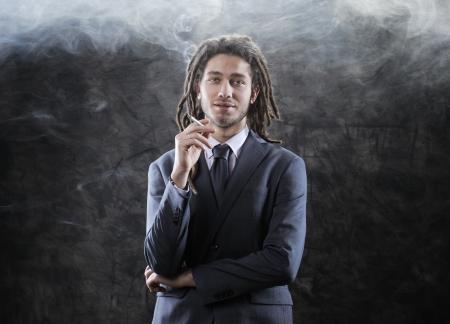 Rastafarian businessman smoking marijuana Stock Photo - 17408713
