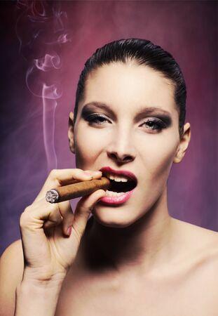 smoking cigar: Attractive young woman smoking a cigar, portrait of fashion model Stock Photo