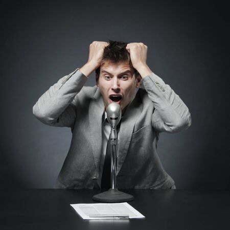 crazy man: Anchorman desperate shouts and gesticulates news Stock Photo