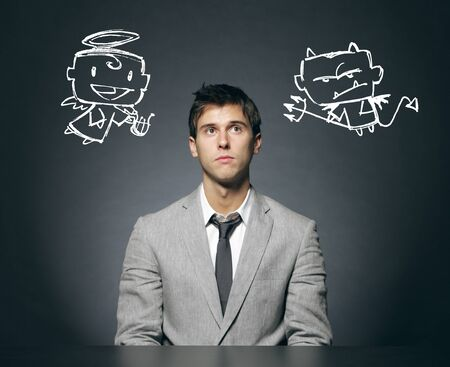 Business man confused with his good and bad conscience Stock Photo - 17625067