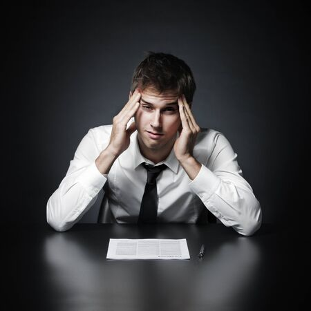Young businessman has the headache photo
