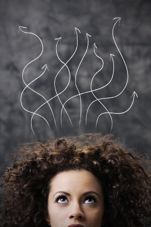 curly hair woman: Thinking young woman in front of question