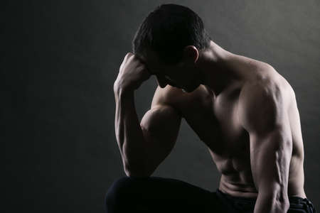 Bodybuilder concentrating on dark background Stock Photo - 17799640