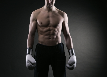 Male fighter posing in front of a dark background Stock Photo - 17799568