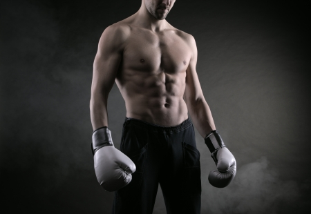 Male fighter posing in front of a dark background Stock Photo - 17799556
