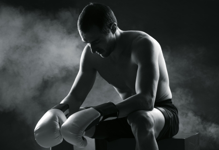 concentrating: Boxer man concentrating on dark background Stock Photo