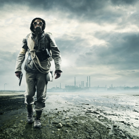 post apocalypse: Environmental disaster. Post apocalyptic survivor in gas mask Stock Photo