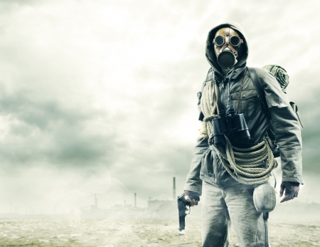 doomsday: Environmental disaster. Post apocalyptic survivor in gas mask Stock Photo