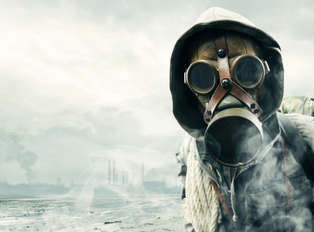 pollution: Environmental disaster. Post apocalyptic survivor in gas mask Stock Photo