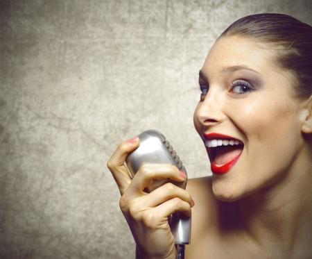 vintage microphone: Beautiful female singer with vintage microphone