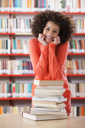 Portrait of smiling female student in library photo