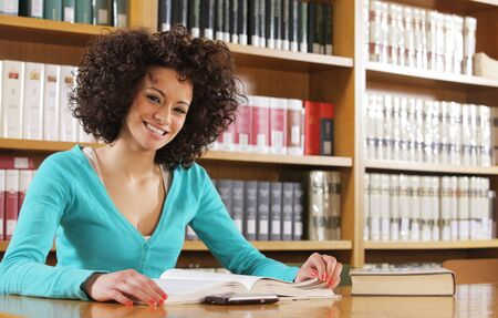 Portrait of cheerful student in library Stock Photo - 17799994