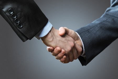 Two business men shaking hands, close up Stock Photo - 18070162