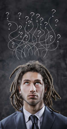 dreadlock: Young businessman looking up at copy space Stock Photo