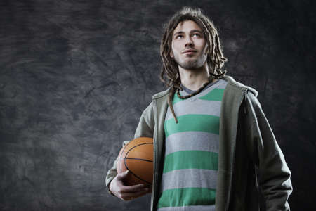 Portrait of young man with basketball photo