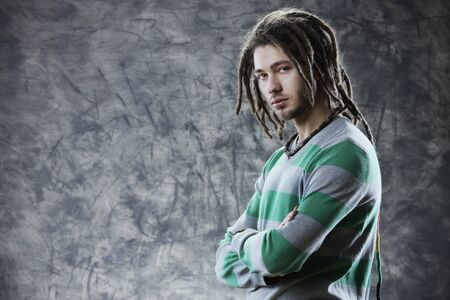 dreadlock: Portrait of Young cool man with dreadlocks  Stock Photo