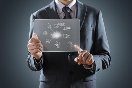 pushing the button: futuristic display: Cloud computing touchscreen interface Stock Photo