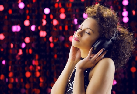young beautiful woman enjoying music photo