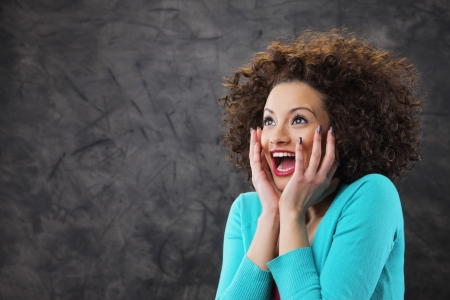 beauty shot: woman looks surprised and happy