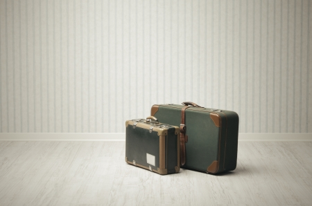 Old-fashioned suitcase alone in a room or station. Stock Photo - 18096913