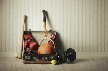 sports equipment: Old Suitcase with sports equipment