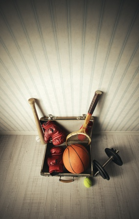 Old Suitcase with sports equipment Stock Photo - 18530371
