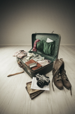 Vintage suitcase open on a wood floor in an empty room Stock Photo - 18530369