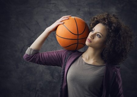 Fashion model  holding a basketball photo