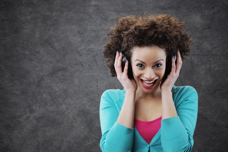 young woman surprised enjoying music photo