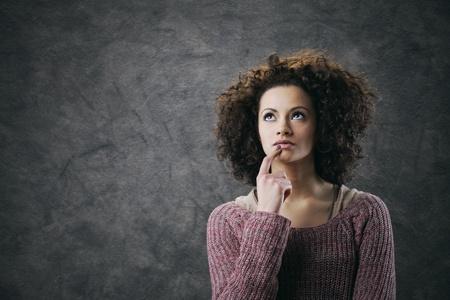 Portrait of young beautiful woman thinking photo