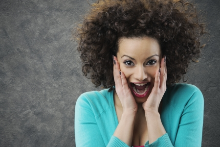curly hair model: woman looks surprised and happy
