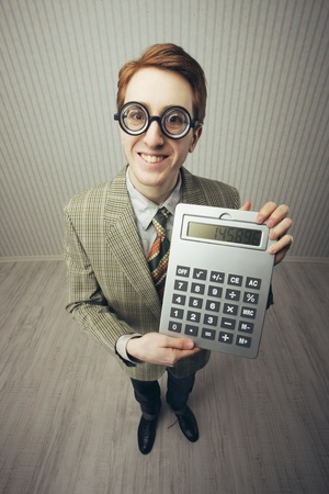 A nerdy guy with a giant-sized calculator  photo
