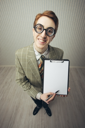 Business man nerd holds a blank sign, ready for your text, old style image photo