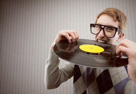bizarre: Nerd student angry, biting a vinyl record
