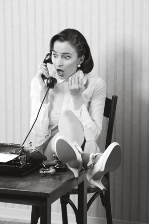 Woman talking on phone with surprised expression Stock Photo - 18530541